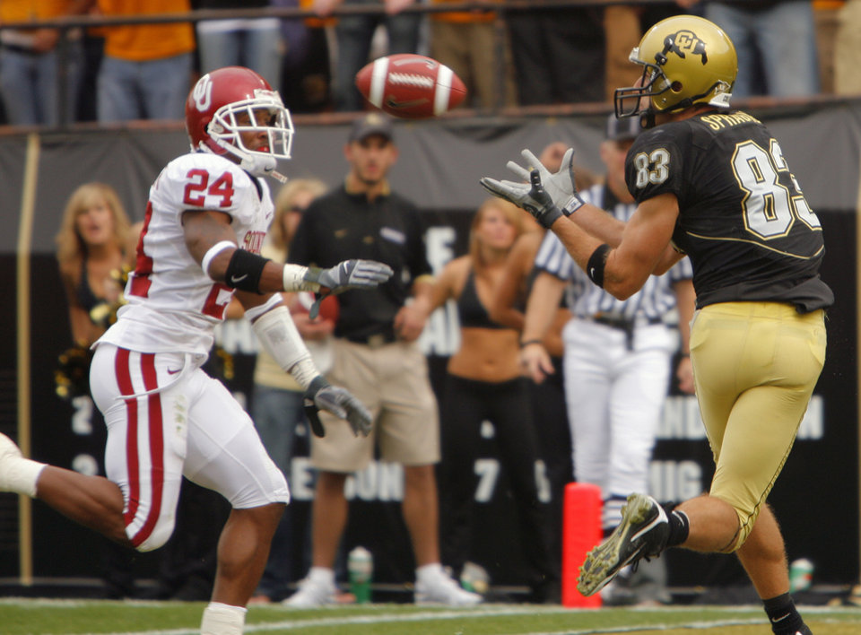 Photo - Colorado's Dusty Sprague (83) pulls in a touchdown pass in front of Oklahoma's Marcus Walker (24) to tie the gaem late in the second half of the college football game between the University of Oklahoma Sooners (OU) and the University of Colorado Buffaloes (CU) at Folsom Field on Saturday, Sept. 28, 2007, in Boulder, Co. 