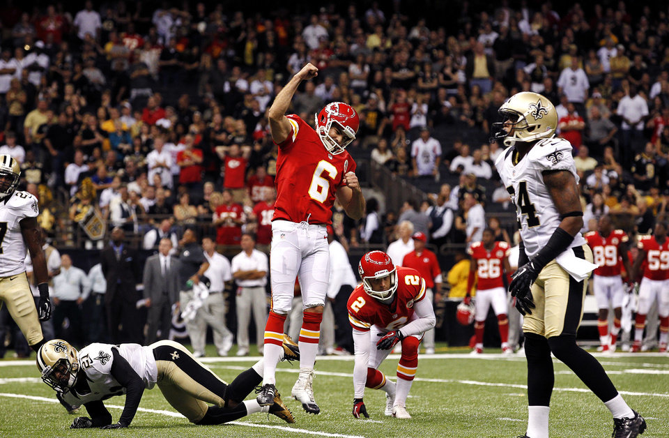 Photo -   Kansas City Chiefs kicker Ryan Succop (6) celebrates his game-winning field goal as New Orleans Saints cornerback Patrick Robinson (21) falls to the turf in overtime of an NFL football game in New Orleans, Sunday, Sept. 23, 2012. The Chiefs won 27-24. (AP Photo/Jonathan Bachman)