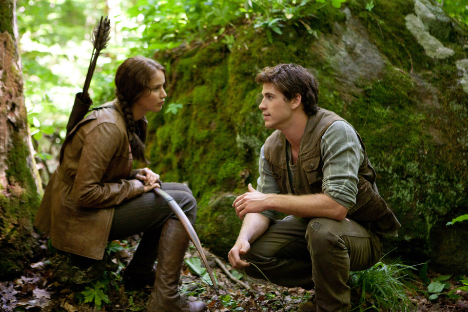 "In this image released by Lionsgate, Jennifer Lawrence portrays Katniss Everdeen, left, and Liam Hemsworth portrays Gale Hawthorne in a scene from ""The Hunger Games."" (AP Photo/Lionsgate, Murray Close) ORG XMIT: NYET515"