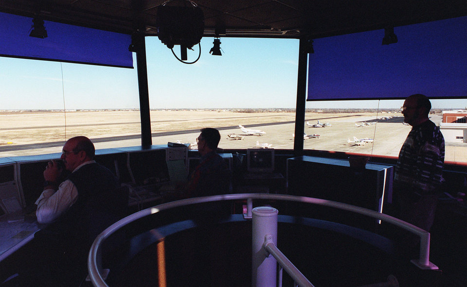 Photo - FILE PHOTO: Air traffic controllers inside Norman's Max Westheimer Airport, one of six towers in Oklahoma set to close due to FAA budget cuts.  ROGER KLOCK