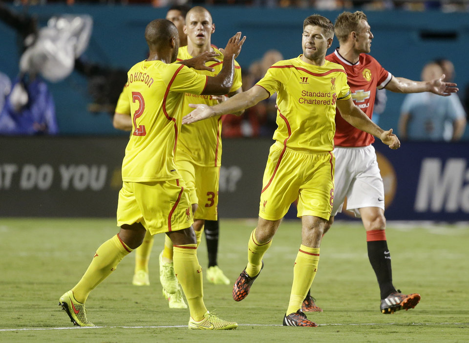 Photo - Liverpool's Steven Gerrard, right, is congratulated by Glen Johnson (2) after scoring a goal against  against Manchester United in the first half during the final of the Guinness International Champions Cup soccer match, Monday, Aug. 4,  2014, in Miami Gardens, Fla. (AP Photo/Lynne Sladky)