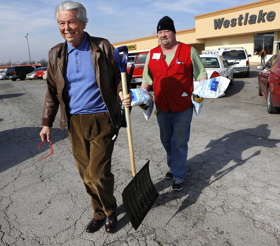Gaylan Adams , Oklahoma City, carries his new snow shovel to his truck, followed by store employee Brent Gier who is carrying two bags of ice melt for Adams. The threat of a severe winter storm, expected to arrive in Oklahoma City on Christmas Day,  ushered a throng of customers into the Westlake Hardware Store, 1509 W. Britton Road,  to purchase snow shovels, ice melt, snow scrapers and tubes filled with sand on Monday, Dec. 24, 2012, Photo by Jim Beckel, The Oklahoman