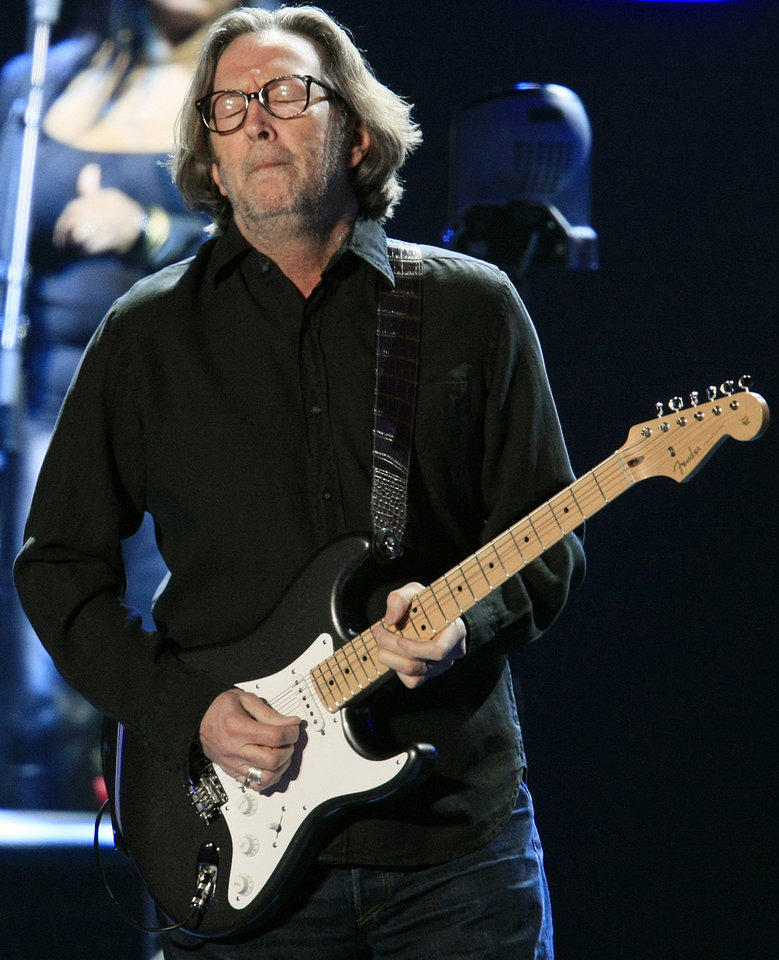 Photo - Eric Clapton performs at the BOK Center in 2010. Photo by STEPHEN HOLMAN,  Tulsa World