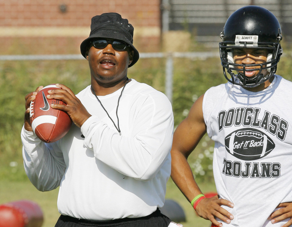 Photo - The Douglass football program has been the most successful in the Oklahoma City Public Schools system. A big part of that is that Willis Alexander, left, is only the eighth coach in school history. THE OKLAHOMAN ARCHIVE