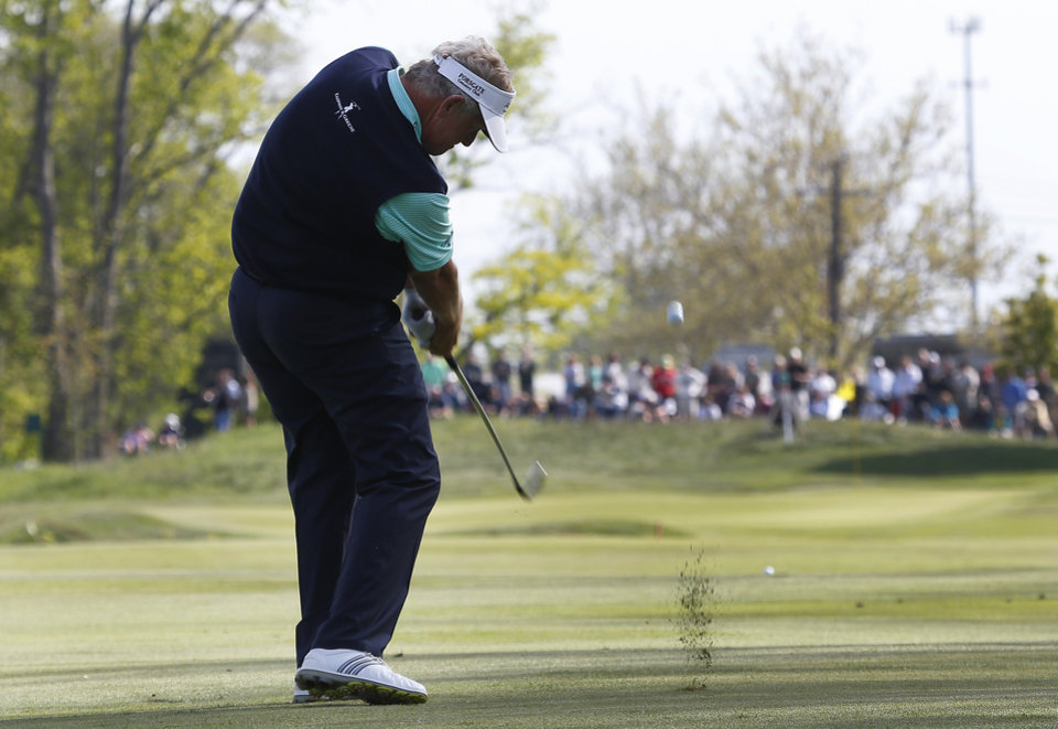 Photo - Colin Montgomerie hits from the fairway on the 16th hole during the third round of the 75th Senior PGA Championship golf tournament at Harbor Shores Golf Club in Benton Harbor, Mich., Saturday, May 24, 2014. (AP Photo/Paul Sancya)