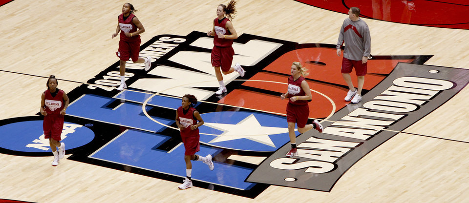 Members of the OU team run across the floor during practice for the Final Four of the NCAA women's  basketball tournament at the Alamodome in San Antonio, Texas., on Saturday, April 3, 2010.  The University of Oklahoma will play Stanford on Sunday, April 4, 2010.