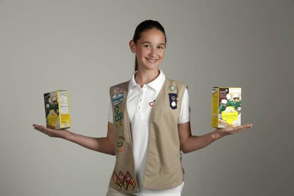 Photo -  Girl Scout cookie sales record-breaker Katie Francis poses at the OPUBCO studio, Thursday, April 10, 2014. Photo by Doug Hoke, The Oklahoman