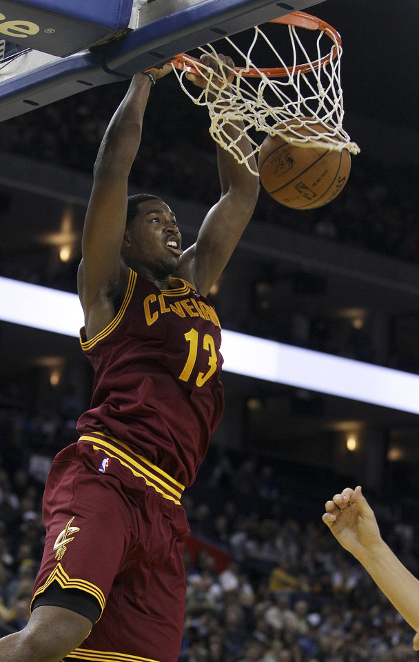 Cleveland Cavaliers forward Tristan Thompson (13) dunks against the Golden State Warriors during the second quarter of an NBA basketball game in Oakland, Calif., Wednesday, Nov. 7, 2012. (AP Photo/Jeff Chiu)