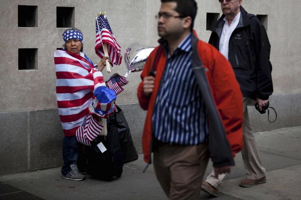 Iness Martez, left, of Newark, N.J., sells American flags at ground zero following the announcement of the death of al-Qaida leader Osama bin Laden, Monday, May 2, 2011, in New York. (AP Photo/John Minchillo) ORG XMIT: NYR103