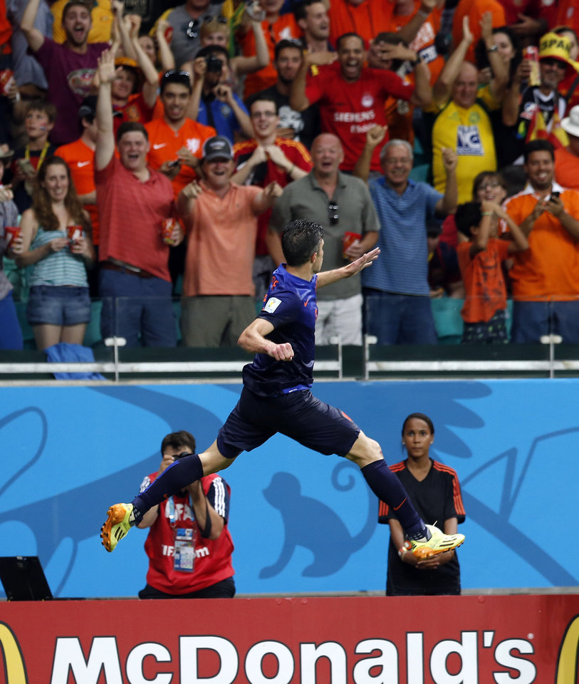 Photo - Netherlands' Robin van Persie celebrates after his scoring his side's fourth goal during the second half of the group B World Cup soccer match between Spain and the Netherlands at the Arena Ponte Nova in Salvador, Brazil, Friday, June 13, 2014. (AP Photo/Wong Maye-E)