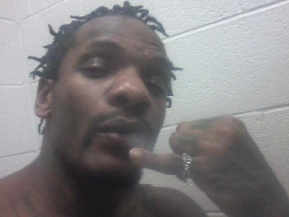 Dante Kennybrew blows smoke in this photo posted on his Facebook page on Dec. 5. Kennybrew, 31, was convicted of robbery in 2007. He is serving a 12-year term in the Lawton Community Corrrections Center. <strong>Facebook - Facebook</strong>