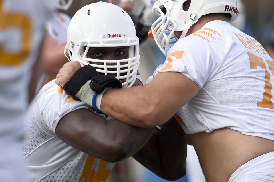 Photo - University of Tennesse offensive lineman Marques Pair, left, matches up against Kyler Kerbyson during the first football practice at Haslam Field, Friday, Aug. 1, 2014 in Knoxville, Tenn. (AP Photo/The Knoxville News Sentinel, Amy Smotherman Burgess)