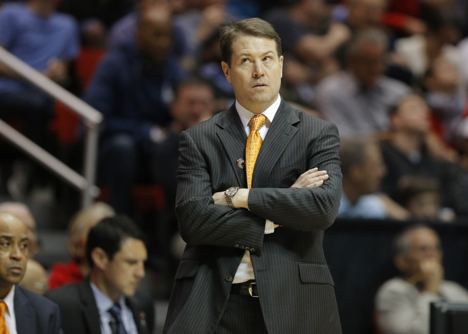 Photo - OSU coach Travis Ford watches his team during a second round game of the NCAA men's college basketball tournament at Viejas Arena in San Diego, between Oklahoma State and Gonzaga Friday, March 21, 2014. Gonzaga won 85-77. Photo by Bryan Terry, The Oklahoman