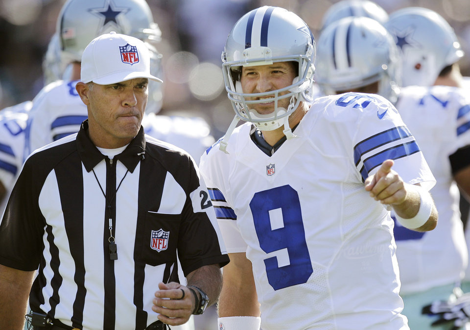 Photo -   Dallas Cowboys quarterback Tony Romo (9) talks with an official during the first quarter of an NFL preseason football game against the Oakland Raiders in Oakland, Calif., Monday, Aug. 13, 2012. (AP Photo/Ben Margot)