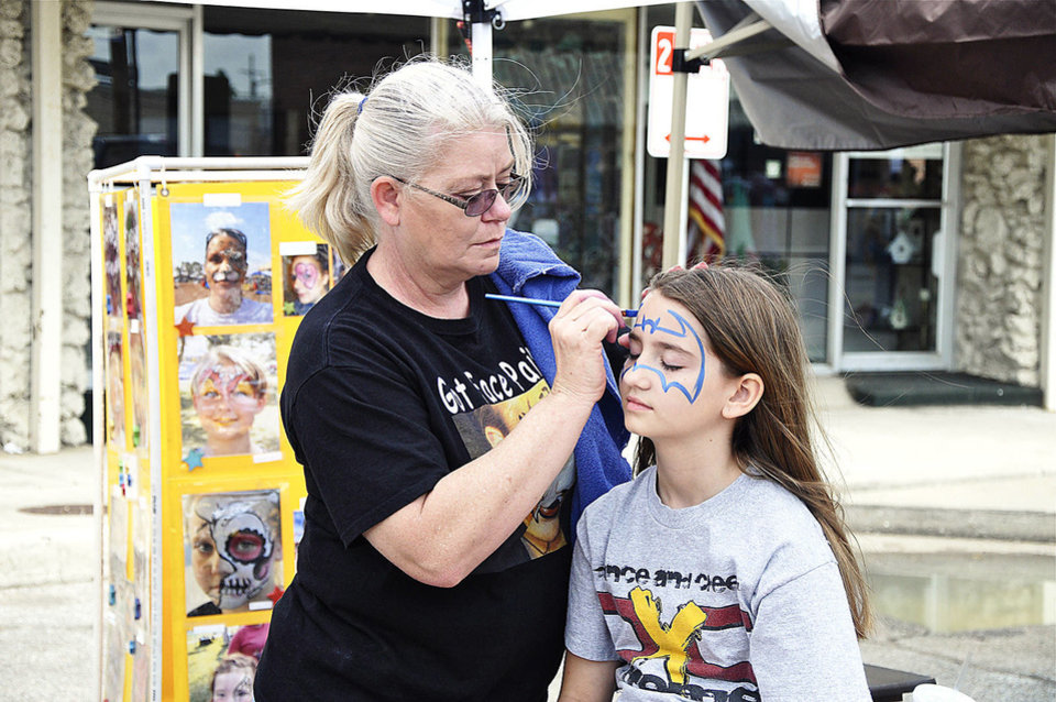 Jan Cates paints Presley Turley's face during Saturday's Bethany 66 Festival. PHOTO BY M. TIM BLAKE, FOR THE OKLAHOMAN <strong></strong>