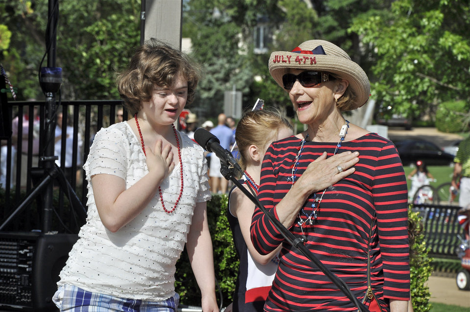 Photo -  Anna Poole, left, recites the Pledge of Allegiance along with event organizer Wiley Hugos during the Nichols Hills Fourth of July celebration. Photo by M. Tim Blake, for The Oklahoman   M. Tim Blake