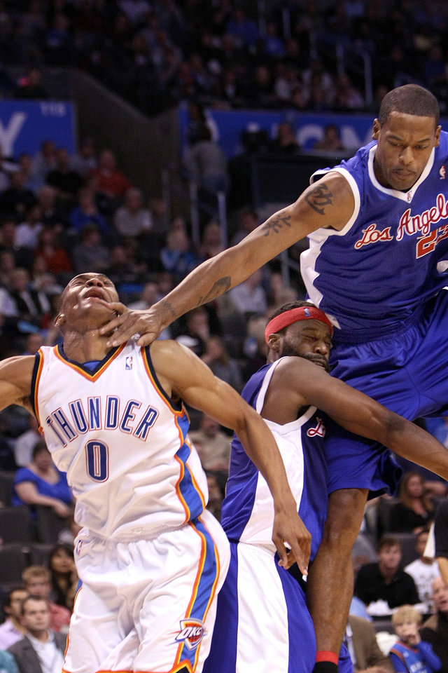 L.A. Clippers' center Marcus Camby gets his finger caught in Thunder guard Russell Westbrook's mouth while colliding with Clippers' guard Baron Davis during the Thunder - Clippers game November 15, 2009 in the Ford Center in Oklahoma City.    BY HUGH SCOTT, THE OKLAHOMAN