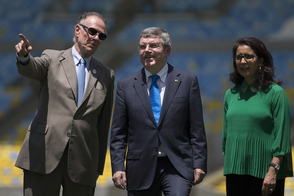 Photo - International Olympic Committee (IOC) President Thomas Bach, center, Nawal El Moutawakel, head of the IOC Evaluation Commission, right, and President of Brazil's Olympic Committee Carlos Arthur Nuzman, center, visit Maracana stadium in Rio de Janeiro, Brazil, Wednesday, Jan. 22, 2014. The city of Rio de Janeiro will host the Olympics in 2016. (AP Photo/Felipe Dana)