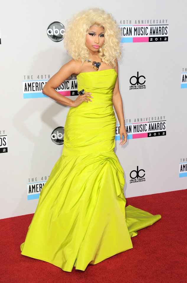 Photo -   Nicki Minaj arrives at the 40th Anniversary American Music Awards on Sunday, Nov. 18, 2012, in Los Angeles. (Photo by Jordan Strauss/Invision/AP)