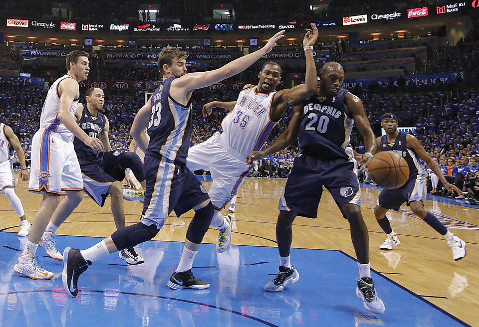 Oklahoma City\'s Kevin Durant (35) battles for the ball with Memphis\' Marc Gasol (33) and Quincy Pondexter (20) during the second round NBA playoff basketball game between the Oklahoma City Thunder and the Memphis Grizzlies at Chesapeake Energy Arena in Oklahoma City, Sunday, May 5, 2013. Photo by Chris Landsberger, The Oklahoman