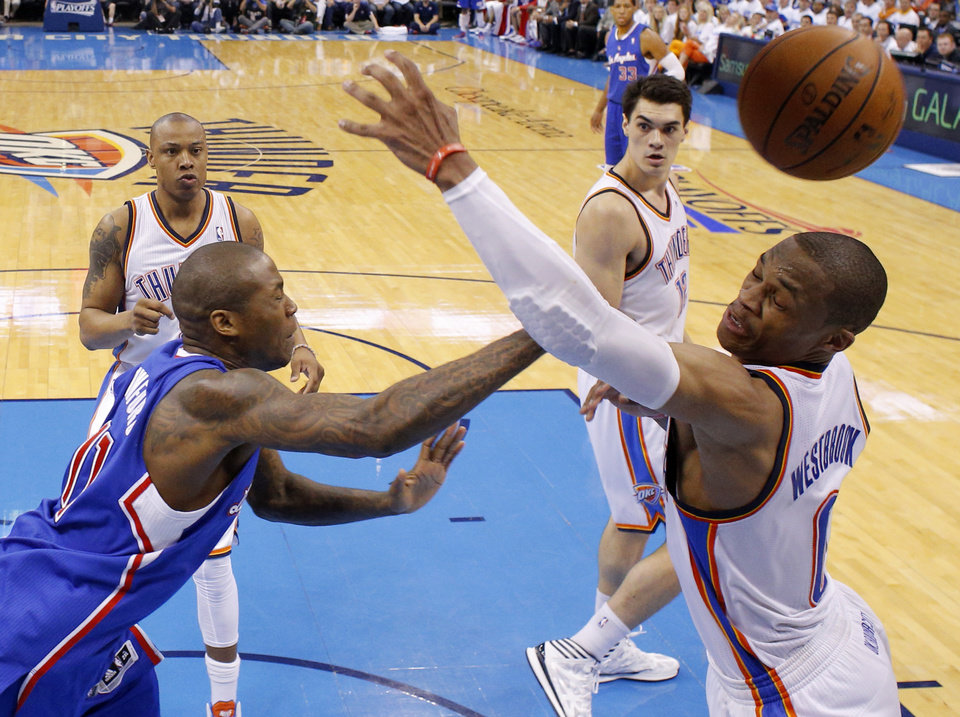 Photo - Oklahoma City's Russell Westbrook (0) goes for a loose ball beside Los Angeles' Jamal Crawford (11) during Game 2 of the Western Conference semifinals in the NBA playoffs between the Oklahoma City Thunder and the Los Angeles Clippers at Chesapeake Energy Arena in Oklahoma City, Wednesday, May 7, 2014. Photo by Bryan Terry, The Oklahoman