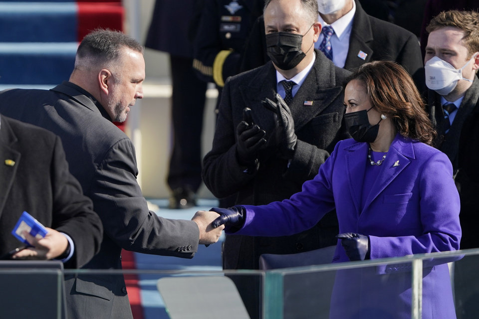 Photo - Garth Brooks shakes Vice President Kamala Harris's hand after singing Amazing Grace during the 59th Presidential Inauguration at the U.S. Capitol in Washington, Wednesday, Jan. 20, 2021. (AP Photo/Patrick Semansky, Pool)