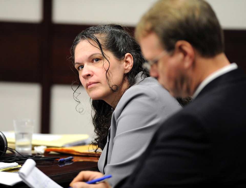 Dee Dee Moore sits in court Monday morning, Dec. 10th, 2012. A Tampa Judge has barred Moore from sitting in the courtroom after he said she may have threatened members of the jury. Prosecutors say Moore, 40, swindled Abraham Shakespeare out of his $17 million lottery winnings and killed him.      (AP Photo/The Tampa Tribune, Cliff McBride)  ST. PETERSBURG OUT; LAKELAND OUT; BRADENTON OUT; MAGS OUT; LOCAL TV OUT; WTSP CH 10 OUT; WFTS CH 28 OUT; WTVT CH 13 OUT; BAYNEWS 9 OUT (REV-SHARE) (ONLN OUT; IONLN OUT - MBI)