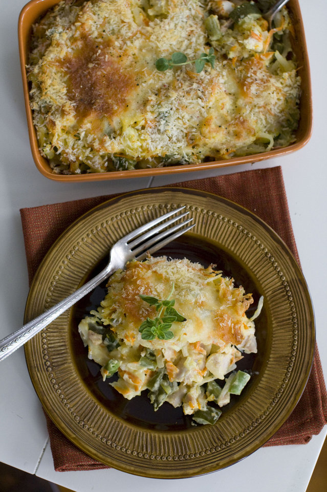 Creamy chicken and potato casserole is mixed in the same dish in which it\'s baked Matthew Mead - AP