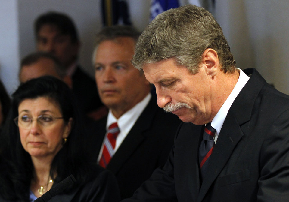 Jim Letten, U.S. Attorney for the Eastern District, announces his resignation during a news conference in New Orleans, Thursday, Dec. 6, 2012. Seconld left is his wife JoAnn Letten. Letten said his resignation is effective Dec. 11 and that he plans to stay on with the department briefly to help with the transition in leadership. (AP Photo/Gerald Herbert)