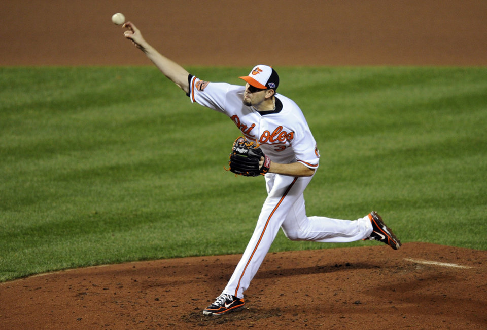 Baltimore Orioles starting pitcher Jason Hammel throws to the New York Yankees in the fourth inning of Game 1 of the American League division baseball series on Sunday, Oct. 7, 2012, in Baltimore. (AP Photo/Nick Wass)