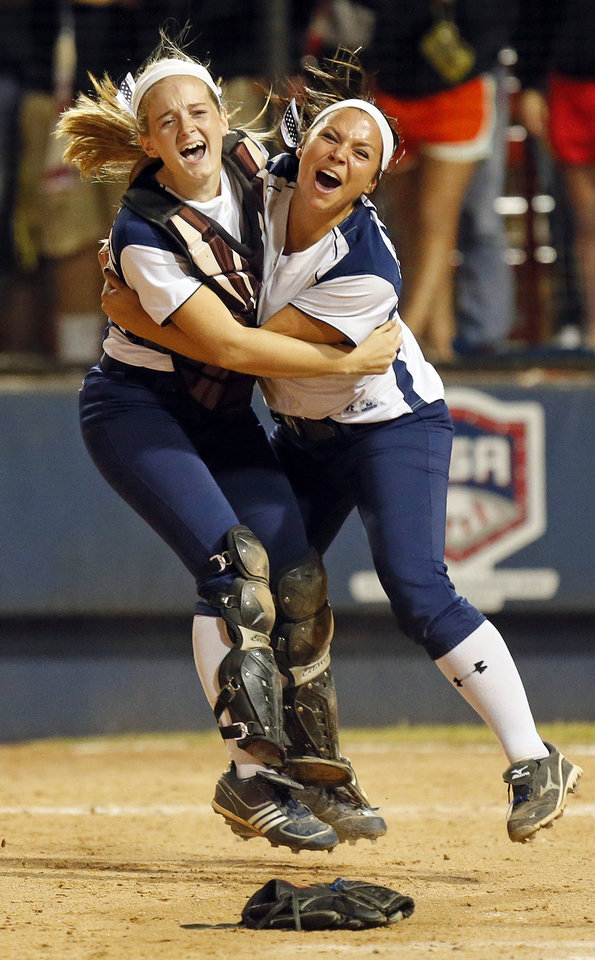 Photo - Edmond North's Ashtyn Crouch (24), left, and Jordan Dixon (11) celebrate after Edmond North won the 6A state championship fast-pitch softball game against Moore at ASA Hall of Fame Stadium in Oklahoma City, Monday, Oct. 15, 2012. Edmond North won, 11-2. Photo by Nate Billings, The Oklahoman