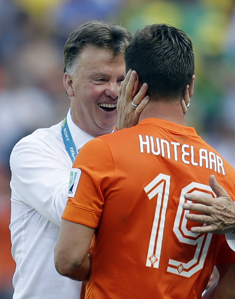 Photo - head coach Louis van Gaal greets Netherlands' Klaas-Jan Huntelaar after the World Cup round of 16 soccer match between the Netherlands and Mexico at the Arena Castelao in Fortaleza, Brazil, Sunday, June 29, 2014. The Netherlands won the match 2-1. (AP Photo/Natacha Pisarenko)
