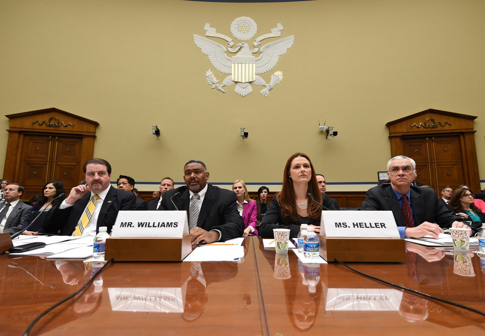 Photo - Witnesses listen to opening remarks before testifying before the House Oversight and Government Reform full committee hearing, Wednesday, May 7, 2014, in Washington. Shown from left are Patrick Sullivan, Assistant Inspector General for Investigations, Office of Inspector General, EPA, Allan Williams, Deputy Assistant Inspector General for Investigations, Office of Inspector General, EPA, Elisabeth Heller Drake, Special Agent, Office of Investigations, Office of Inspector General, EPA and Bob Perciasepe, Deputy Administrator, EPA.  (AP Photo/Molly Riley)