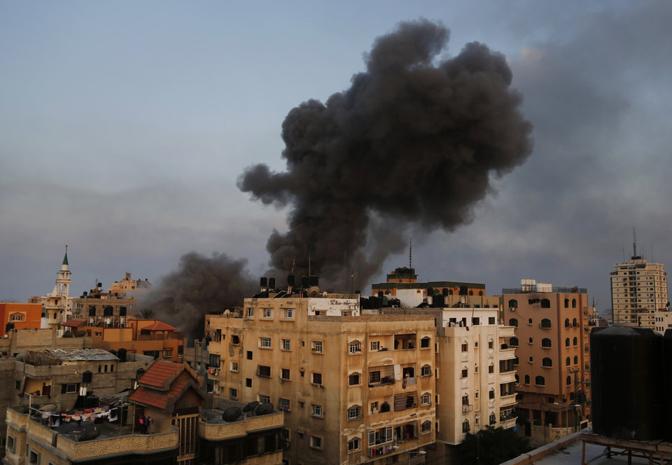 Photo - Smoke rises from the offices of the Hamas movement's Al-Aqsa satellite TV station, in Gaza City, northern Gaza Strip, shortly after was hit and destroyed by an Israeli strike, Tuesday, July 29, 2014. Early Tuesday, Israel warplanes struck a series of targets in Gaza City, including the top Hamas leader in Gaza, Ismail Haniyeh's house and government offices, while Gaza's border area with Israel was hit by heavy tank shelling. (AP Photo/Hatem Moussa)