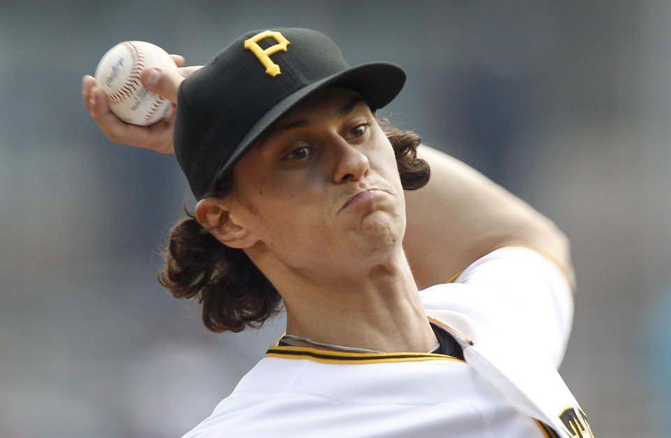 Photo -   Pittsburgh Pirates relief pitcher Jeff Locke throws against the Chicago Cubs in the first inning of the baseball game on Sunday, Sept. 9, 2012, in Pittsburgh. (AP Photo/Keith Srakocic)