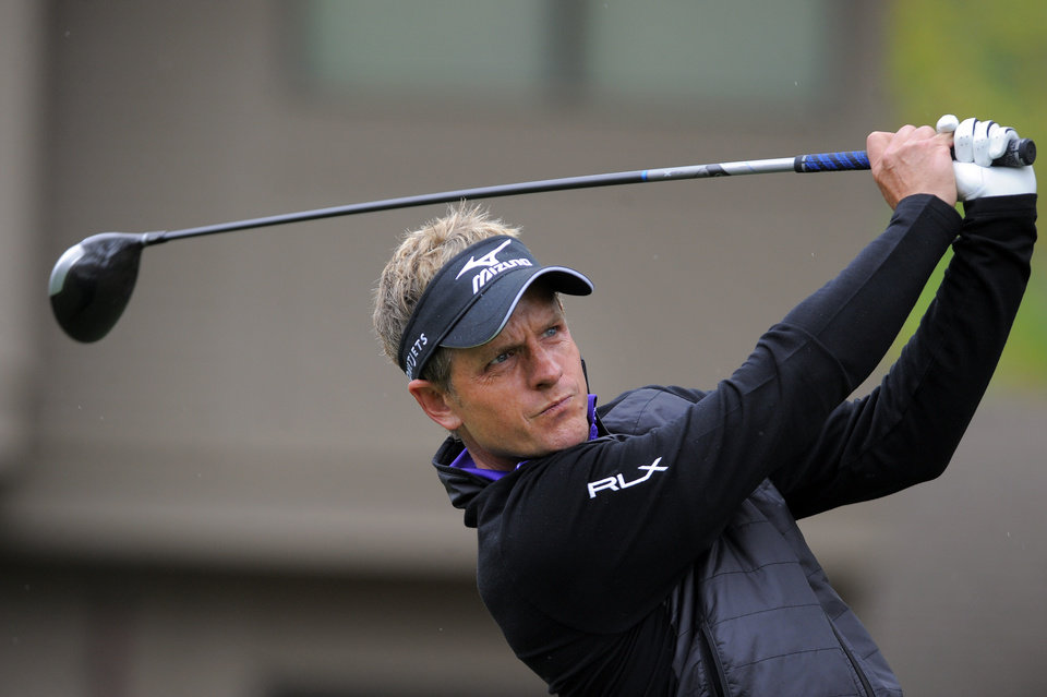 Photo - Luke Donald, of England, tees off on the third hole during the second round of the RBC Heritage golf tournament in Hilton Head Island, S.C., Friday, April 18, 2014. (AP Photo/Stephen B. Morton)