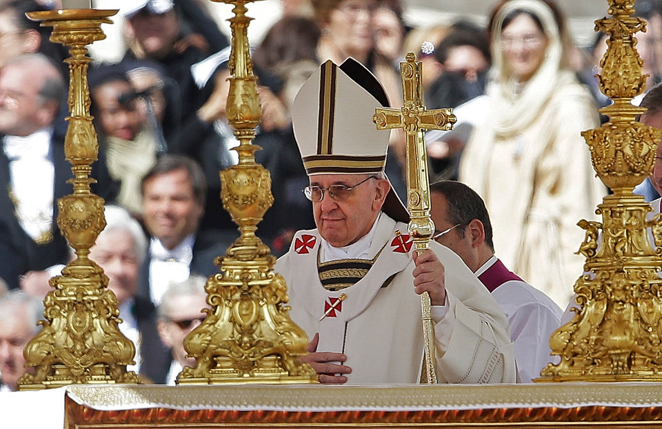 Pope Francis walks past the alter in front of St. Peter's Basilica in St. Peter's Square following his inauguration Mass at the Vatican, Tuesday, March 19, 2013.  (AP Photo/Gregorio Borgia)