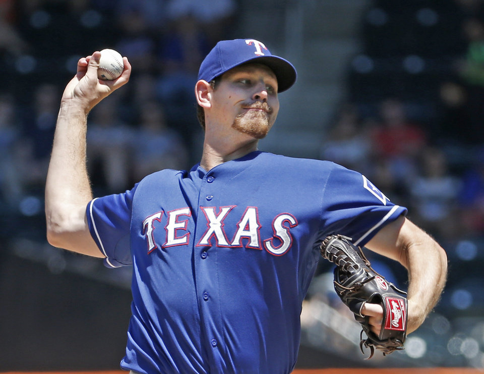 Photo - Texas Rangers starting pitcher Nick Tepesch delivers against the New York Mets in a baseball game in New York, Sunday, July 6, 2014. (AP Photo/Kathy Willens)