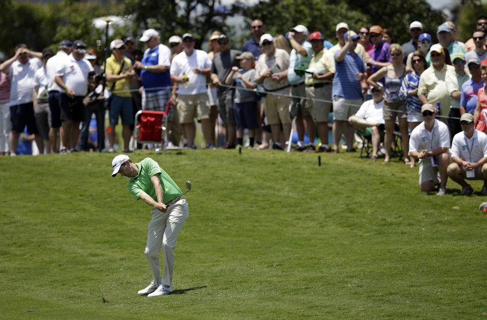 Photo - Brendon Todd hits out of the rough along the first fairway during the final round of the Byron Nelson Championship golf tournament, Sunday, May 18, 2014, in Irving, Texas. (AP Photo/Tony Gutierrez)