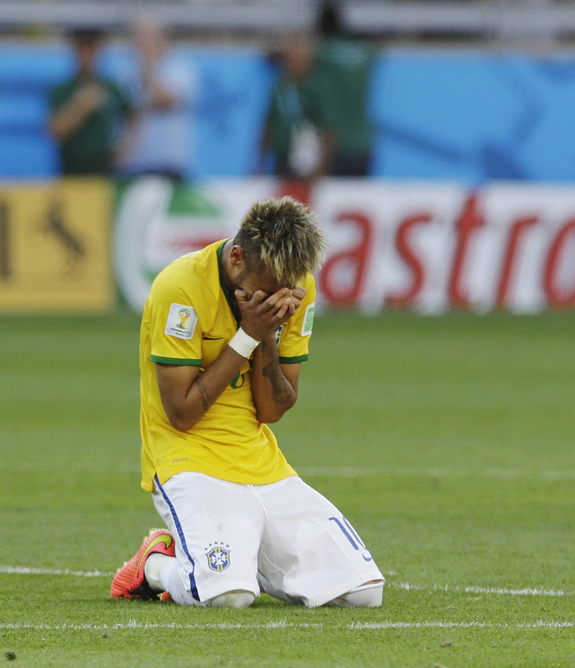 Photo - Brazil's Neymar reacts after a penalty shootout following regulation time during the World Cup round of 16 soccer match between Brazil and Chile at the Mineirao Stadium in Belo Horizonte, Brazil, Saturday, June 28, 2014. Brazil won 3-2 on penalties after a 1-1 tie. (AP Photo/Ricardo Mazalan)