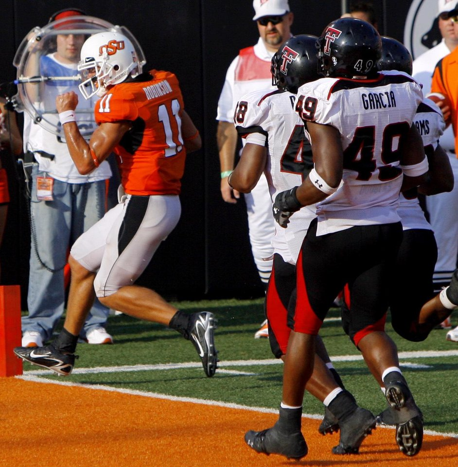 Photo - OSU quarterback Zac Robinson (11) celebrates as he runs into the endzone for a touchdown in the third quarter during the college football game between the Oklahoma State University Cowboys (OSU) and the Texas Tech University Red Raiders (TTU) at Boone Pickens Stadium  on Saturday, Sept. 22, 2007, in Stillwater, Okla. 
