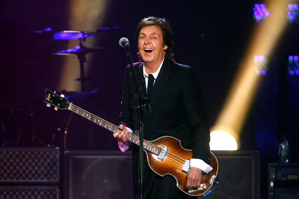 Photo - FILE- In this June 8, 2013 file photo, Paul McCartney performs during a concert at the Barclays Center, in New York. McCartney is canceling his entire Japan tour. The former Beatle got a virus last week and canceled several appearances, apologizing online to his fans. Now, his organizers say he is not well enough to do any of the concerts in Japan, including the one set for Wednesday, May 21, 2014, at Nippon Budokan hall, where the Beatles performed during their first 1966 Japan tour. (Photo by Jason DeCrow/Invision/AP, File)