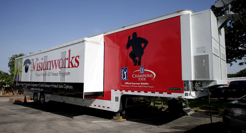 Photo - A training trailer for tour players is seen in a parking lot during the U.S. Senior Open at Oak Tree National in Edmond, Okla., Tuesday, July 8, 2014. Photo by Bryan Terry, The Oklahoman