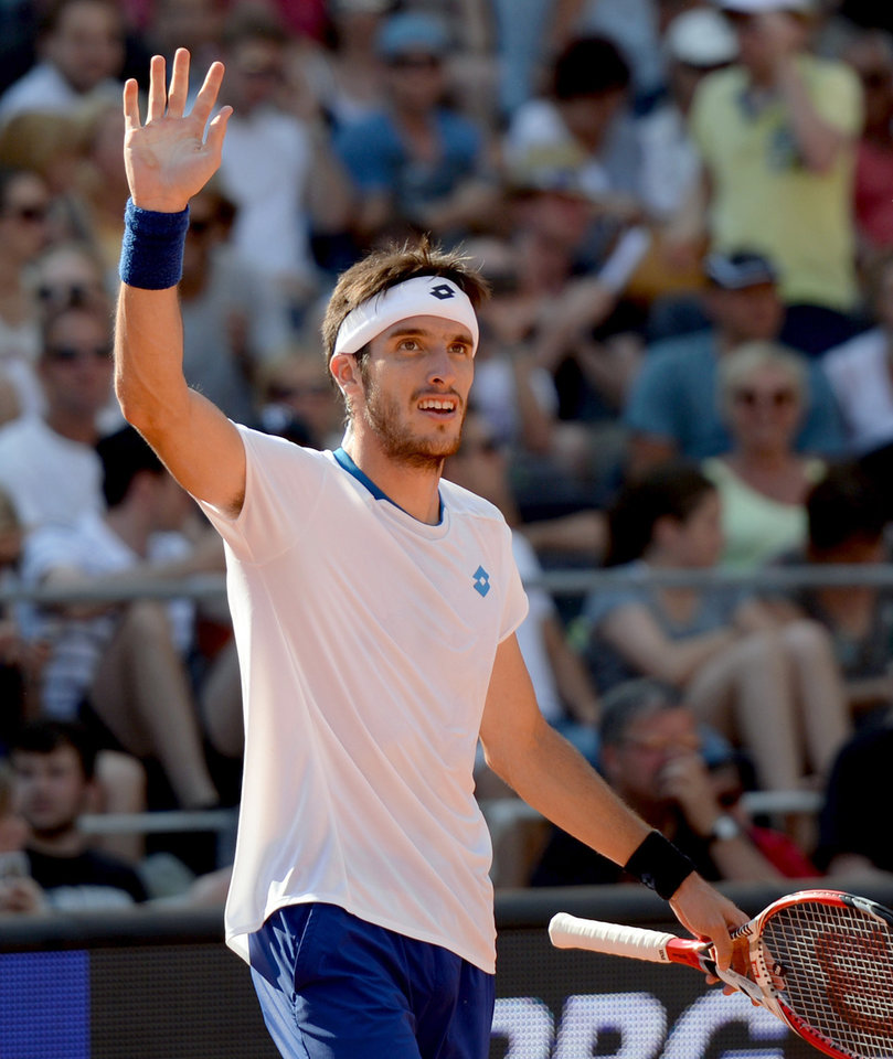 Photo - Leonardo Mayer of Argentina celebrates after defeating Germany's Philipp Kohlschreiber in their semi final match with 7-5 and 6-4 at the German Open tennis tournament in Hamburg, Germany, Saturday, July 19, 2014. (AP Photo/dpa, Daniel Reinhardt)