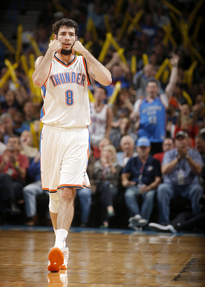 Photo - Oklahoma City's Alex Abrines (8) celebrates after a 3-pointer during an NBA basketball game between the Oklahoma City Thunder and the Milwaukee Bucks at Chesapeake Energy Arena in Oklahoma City, Tuesday, April 4, 2017. Photo by Bryan Terry, The Oklahoman