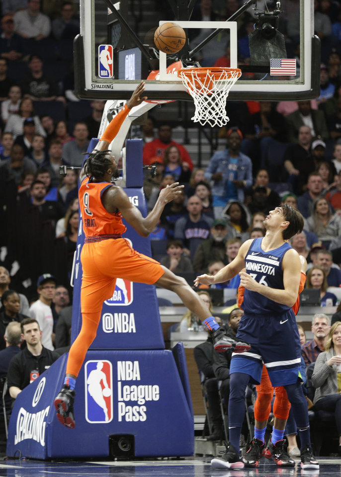Photo - Oklahoma City Thunder forward Jerami Grant (9) puts up a shot over Minnesota Timberwolves forward Dario Saric, of Croatia, (36) during the first half of an NBA basketball game Sunday, April 7, 2019, in Minneapolis. Oklahoma City won 132-126. (AP Photo/Paul Battaglia)