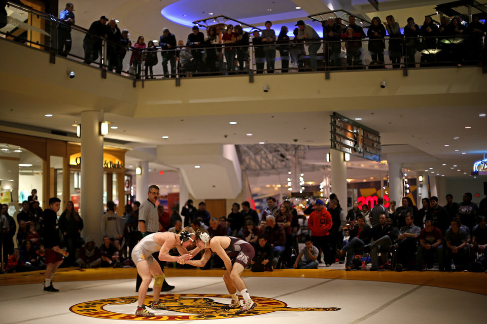 Gage Hendrix of Putnam CIty North, left, wrestles Seth Graves of Edmond Memorial during a wrestling match inside Quail Springs Mall in Oklahoma City, Thursday, Jan. 23, 2014. Photo by Bryan Terry, The Oklahoman