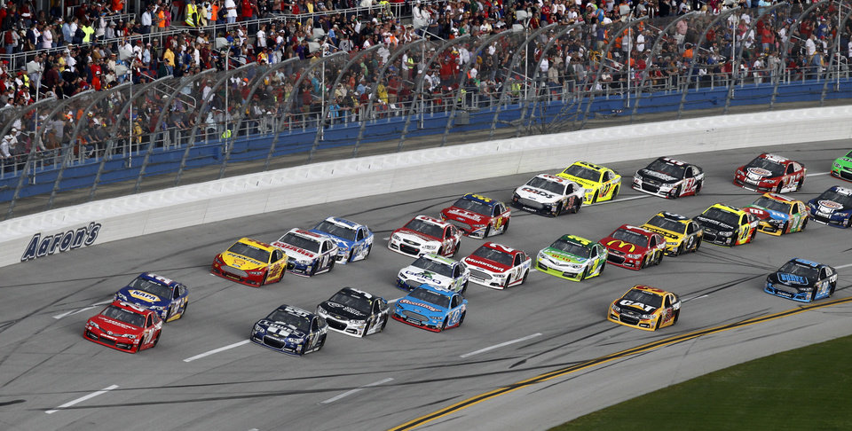 NASCAR Sprint Cup Series driver Matt Kenseth leads a pack of cars through the tri-oval in the Aaron's 499 auto race at Talladega Superspeedway in Talladega, Ala., Sunday, May 5, 2013. (AP Photo/Butch Dill)