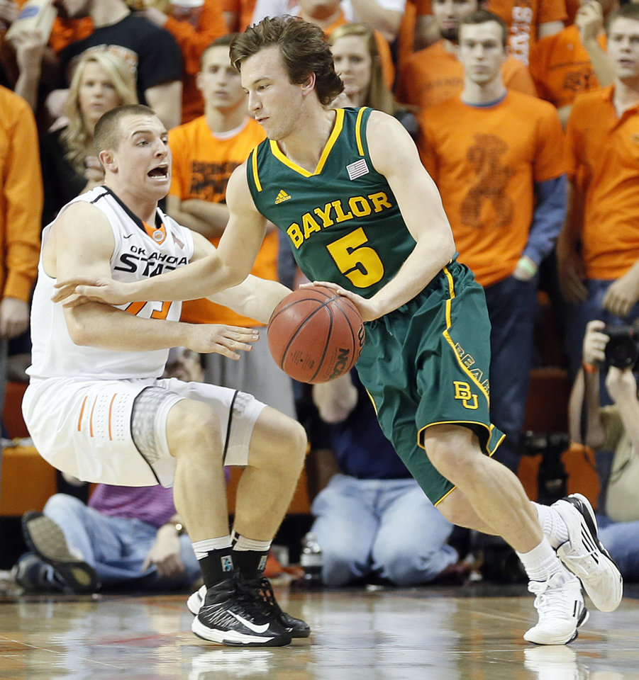 Oklahoma State 's Phil Forte (13) defends on Baylor's Brady Heslip (5) during the college basketball game between the Oklahoma State University Cowboys (OSU) and the Baylor University Bears (BU) at Gallagher-Iba Arena on Wednesday, Feb. 5, 2013, in Stillwater, Okla. Photo by Chris Landsberger, The Oklahoman