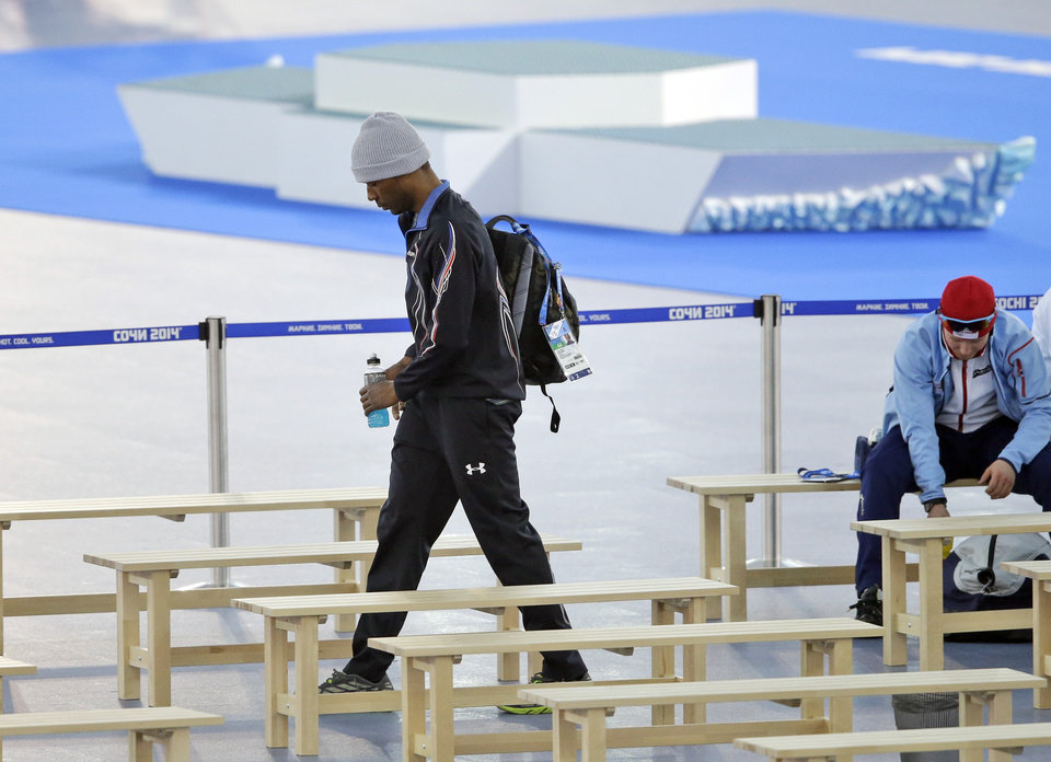 Photo - Shani Davis of the U.S. leaves the arena after the men's 1,500-meter speedskating race at the Adler Arena Skating Center during the 2014 Winter Olympics in in Sochi, Russia, Saturday, Feb. 15, 2014. (AP Photo/David Goldman)